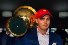 10/11/15: Rickie Fowler Carries The Presidents Cup Trophy After His Team's Victory Against The International Team During Sunday singles Matches In The Final Round Of The 2015 Presidents Cup At Jack Nicklaus Golf Club Korea.