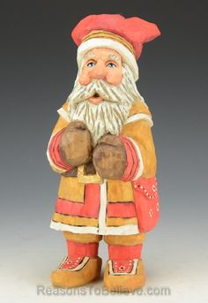 """""""Sami Claus - Scandinavian Santa in great detail from head to toe, bundled up nicely. A hand crafted Santa Claus figure, carved from solid wood. Designed, carved by hand, painted, finished and signed by Russell Scott."""""""