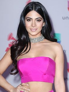 Emeraude Toubia's long, loose waves, middle part, bronze eyeshadow and pink lips | allure.com