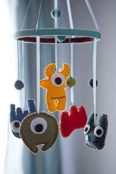 Cute budget idea to go with our monster theme room. Can get felt, ribbon and thread all at the dollar store.