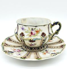 Here is a beautiful and scarce antique Japanese Victorian moriage porcelain cup and saucer c1890. These Victorian era examples are becoming harder to find. #antique #teacupset #coffeetea #afternoontea #rarecollection #hardtofind #kitchendecor #uniquegift #collectorsgiftideas #cabinetdisplay #kitchendecor #teaware #homedecor #antiquecollection