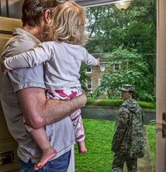 This photo made my day. The caption on the website said he and his daughter had to say goodbye to his wife who was going on a one year unaccompanied tour to Korea. What a great dad! If you can find the website, worth a look at all the pictures.
