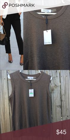 [CALVIN KLEIN] Sleeveless Sweater **CALVIN KLEIN** Knit Shell Sweater. Sleeveless Top with logo at the left hip. Crew neckline. Pullover style. Color brown.            🔹20% Off On 2+ Bundle Offers🔹 Calvin Klein Sweaters Crew & Scoop Necks