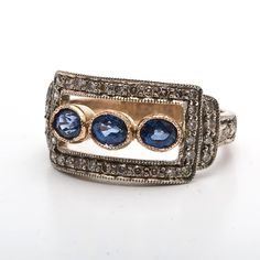 negative s p a c e Estate 18K Gold Blue Saphire Diamond Ring. Chocolate diamonds instead of sapphires.