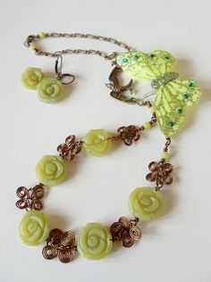 Beautiful Handmade Jewelry Set! This 2 piece set is made with antiqued brass wire and olive jade roses. The focal point of this creation is five olive jade roses surrounded by handmade brass wire scrolls and attached to a antiqued brass chain.  #jewelry #summer #handmade