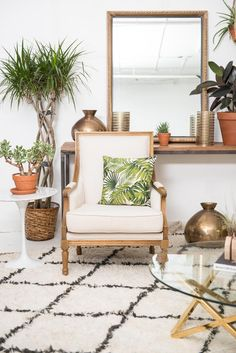 #PatinaZodiacStyle for our Virgo look featuring our popular neutral Amelia chair. Paired this lovely with a marble tulip side table and a beni rug. Pops of gold + plants help complete the look! | Patina
