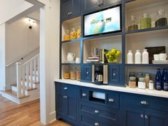 """The breakfast bar is a stand out feature with plenty of storage and a mounted flat-screen TV. """"It's so convenient,"""" says interior designer Linda Woodrum. """"The everyday things that you use are out.""""  http://hg.tv/v8eb"""