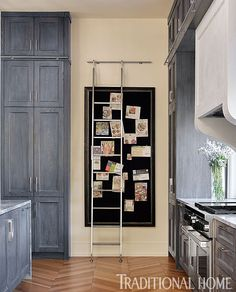 A stainless-steel ladder on a rail provides access to the upper cabinets where rarely used items are stored. - Photo: Emily Jenkins Followill / Design: Joel Kelly with Jonathan Alexander and Lauren Troutman