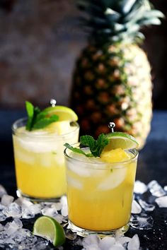 These six ingredient Pineapple Mojitos couldn't be easier and makes four drinks with just 10 minutes of prep time. Fresh mint and limes are muddled together before being doused in pineapple juice, simple syrup, white rum and club soda. Served over ice and Juice Drinks, Fruit Drinks, Yummy Drinks, Yummy Food, Party Drinks, Cocktail Drinks, Yummy Treats, Sweet Treats, Cocktails