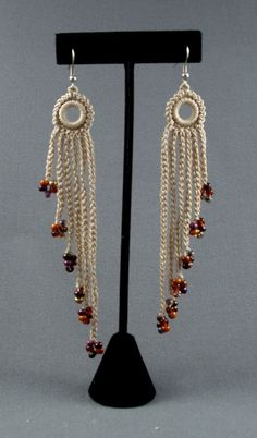 Crochet earrings, my original design, approximately 4 inches long. Note there is a right earring and a left earring.