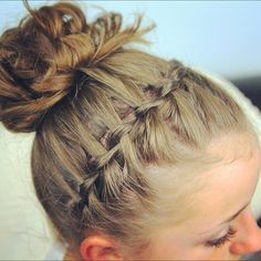 Waterfall braid into a messy bun. Tutorial from cutegirlshairstyles on YouTube.