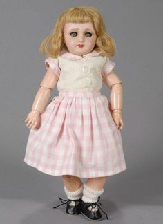 29 cm, Unis France 301, Bleuette model with features that include a perfect bisque head with very nice coloring for the era, blue glass sleep-eyes