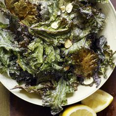 Kale brushed with olive oil, dusted with pepper, sesame seeds and parmesan.  Can become habit-forming, in a good way