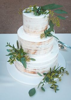 Semi naked wedding cake with greenery at Bella Collina Montverde, Florida