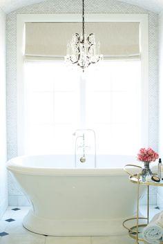 Romantic bathtub nook with freestanding tub, barrel vaulted ceiling, chandelier | Pink Peonies