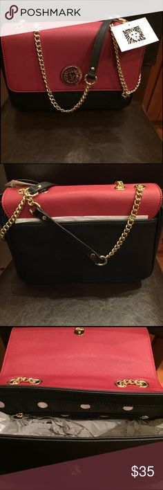 Ann Klein shoulder bag Dark red and black with chain strap that can be lengthened to shoulder or shortened to arm carry. The inside has a open pocket as well as a zipper pocket. Very roomy too. Bags Shoulder Bags