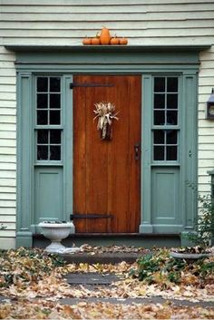 FALL*SPIRATION - Dried Corncob Husk on Antique Stained Door with Painted Surround.
