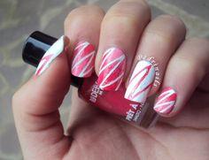 Reverse accent manicure zig-zag stripes pink gradient ombré nail art on white base nail design