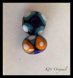 Striking Orange, white and blue handmade glass Beads £4.00