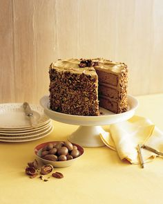 Butterscotch sauce soaks into brown sugar cake layers before they are spread with caramel-cream cheese frosting. Adorn the cake with toasted pecans.