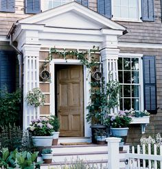 Old Doors  Greet guests with an old front door. Skip the builder's basic and install a front door with age and patina. This pine door, which was salvaged from a ruined building in England, gives its cottage instant character and creates a welcoming entry.