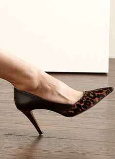 High heel pump with a pointed toe, inset heel and low cut front vamp for a flattering fit.