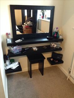 DIY dressing table: I would put all the shelves off to the sides so you could get right up to the mirror if need be