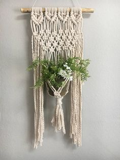 Macrame plant hanger  This item is a freehand pattern Unique fit to any home Fits small to medium size pots   Dimensions *16in width *19in lenght    NOTE- plant is not included