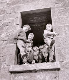 Kids playing in a window in the Gorbals, Glasgow.