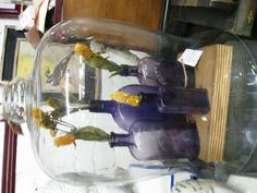 Antique lavender bottles under glass cloche as seen in the Absinthe Vignette at Paris on Ponce....http://www.parisonponce.com