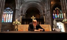 Prince William Photos Photos - Prince William, Duke of Cambridge signs a book of condolence at Manchester Cathedral where he met first responders and members of the local community who provided vital care and support to those affected by last week's suicide bomb attack, including representatives from St John's Ambulance, Northern Rail and the British Red Cross on June 2, 2017 in Manchester, England. - Duke of Cambridge Visits Greater Manchester Police Headquarters