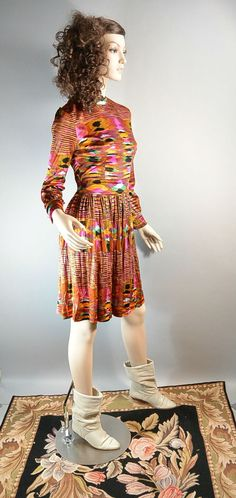 Psychedelic Mad Men dress, mandarin collar, silky fabric. Fits like a small or medium. Excellent condition, does need to be steamed. All measurements taken while garment is laying flat.  shoulders 17 inches  armpit to armpit 17 inches (34 around)  waist 13.5 inches (27 around)  nape to hem 37 inches  sleeves 22 inches | Shop this product here: http://spreesy.com/coupdetatvintage/8 | Shop all of our products at http://spreesy.com/coupdetatvintage    | Pinterest selling powered by…
