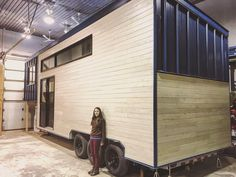 Elyse our talented executive director and associate showing to the world how very small she is @tremblyl #tinyhouseonwheels #woodworking #sustainable #wood #minimalist #minimaliste #tinyhouse #thow #funky #design #designer #exteriordesign #cedar #tinyhome #offthegrid