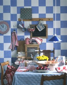 Dining room in blue, white and red. Love her style, though not the checkered wall.