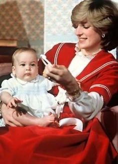 Princess Diana trying to encourage Williams to look at the cameras. He was 6 months old. 1982.