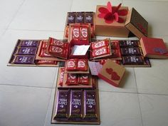 Valentine special chocolate explosion box by Sheetal Khajure,Baking de Chocolates Chocolates aesthetic bars bouquet box brown hair brownies cake candy chip cookies cupcakes day decorations design desserts dibujo fondos frases ganache gift # Paper Gift Box, Diy Gift Box, Diy Box, Surprise Box Gift, Valentines Gift Box, Valentine Special, Birthday Explosion Box, Exploding Gift Box, Chocolate Gift Boxes