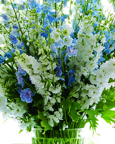 Blue-and-white wildflowers fill a vase in Aerin Lauder's bedroom.