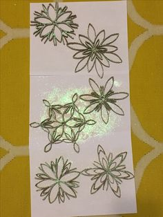 Toilet paper roll snowflakes with glitter