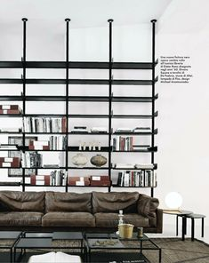 Black vitsoe universal shelving system by Dieter Rams with soft leather sofa
