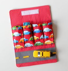 Just got this for my little guy to keep in my purse. It is the cutest idea! He is going to love it!  http://www.etsy.com/listing/162562550/toy-car-garage-with-road