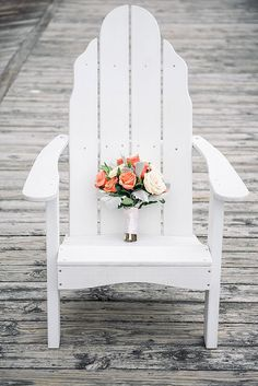 Coral and Ivory Bouquet on an Adirondack Chair    Shannon Moffit Photography   Classic and Elegant Navy Blue and Coral Nautical Wedding
