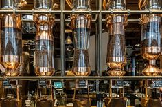 Starbucks announced the opening of its first Reserve Roastery and Tasting Room in the Capitol Hill neighborhood of Seattle. The Roastery will redefine the century retail experience. Starbucks Seattle, Starbucks Reserve, Starbucks Coffee, Willy Wonka Factory, Starbucks Specials, Wonka Chocolate Factory, Coffee Dispenser, Soap Dispenser, Tents