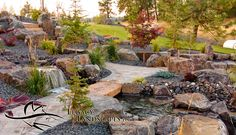 Paver Pathway, Boulder Bridge over Water Feature and Northwest Landscaping