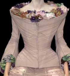 Alexander McQueen fashion Spring 2007 - taupe fitted bodice will full neck and sleeves filled with colourful silk flowers