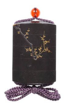 (Reverse). Inro. The dark greenish-grey, matt seido-nuri ground decorated in orange and black takamakie with a haori hanging on a bamboo pole suspended from the branches of a plum tree, the design continuing on the reverse with two butterflies rendered in delicate kebori flitting beneath the plum branches, the interior of rich nashiji; the base signed with scratched characters Zeshin.