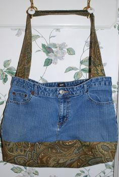 Tote bag from an old pair of jeans -- I referenced the vague tutorial at http://www.lovetosew.com/denimbag.htm but modified it to make the bottom double-layered, the straps made a better way and placed a little differently, the raw edges inside zigzagged, and the seam between the top and bottom top-stitched to make it lie flatter.