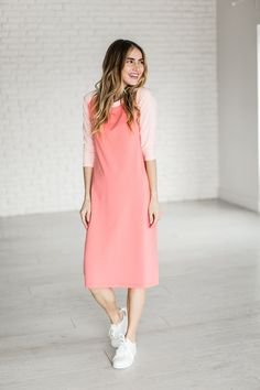 The ultimate in Summer-wear. It is comfy, modest, and stretchy! Coral-y Pink Body with Light Pink Accents. Material is heavy enough to avoid a slip, and stretchy enough for maximum comfort. Fabric con