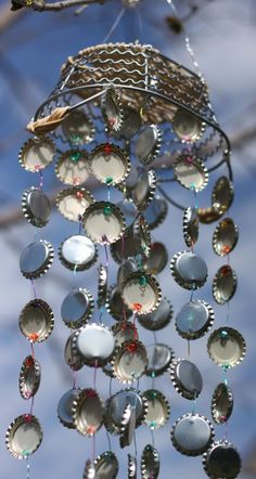 Tutorial - DIY Bottlecap Windchimes with detailed explanation of how they're strung together.