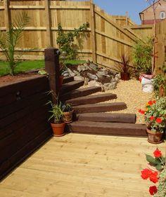 Decorar jardines utilizando traviesas de madera