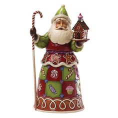 Kerstman Jim Shore Heartwood Creek sweetest Santa Jim Shore's new sweets Santa is a cornucopia of sugary delights. With peppermints and cupcakes and a whole flock of gingerbread men; this St. Nick appeals to anyone who loves a Christmas Eve treat.